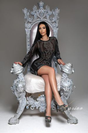 Destinada in black lace top sat on grey throne